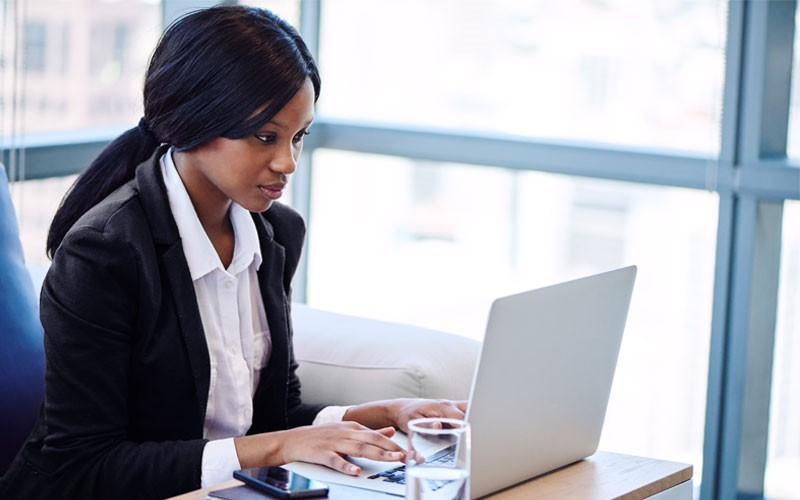 Business woman typing on laptop